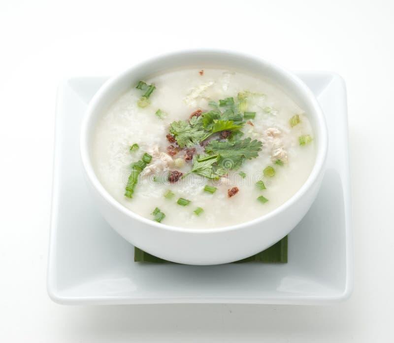 A bowl of porridge. Isolated on white royalty free stock image