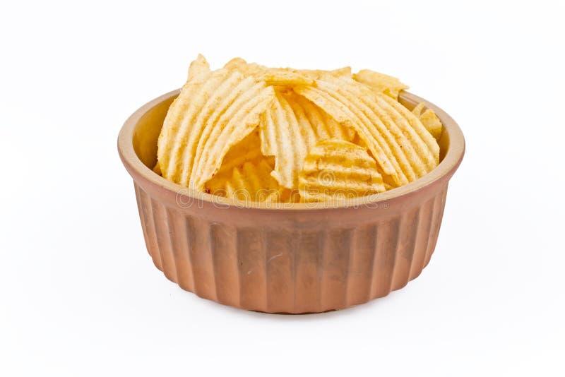 Bowl of potato crisps royalty free stock photos
