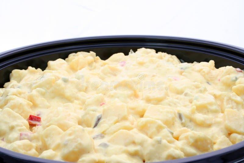 A bowl of potato salad stock photography