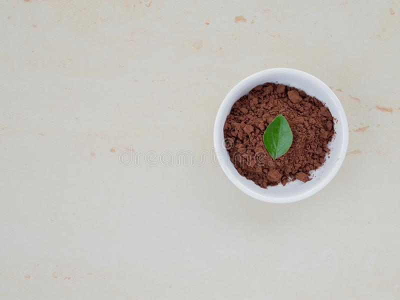 Bowl of powder cocoa. Top view, stone background royalty free stock images