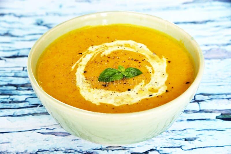 Bowl with pumpkin soup stock photos