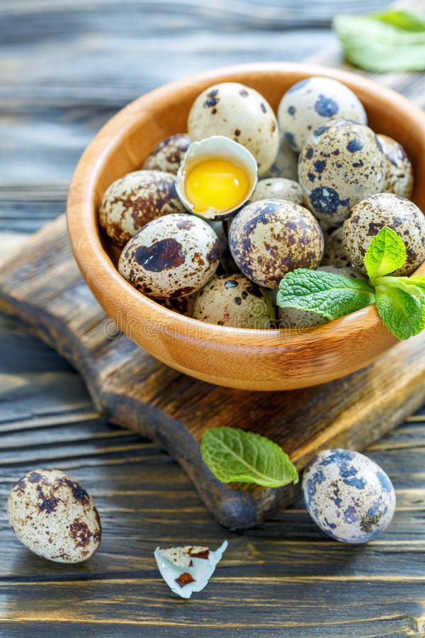 Bowl of quail eggs and the yolk in the shell. royalty free stock photography