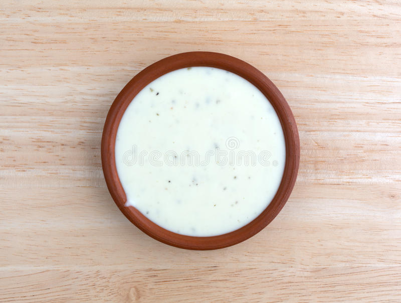 Bowl of ranch dressing on a wood table top view royalty free stock photos