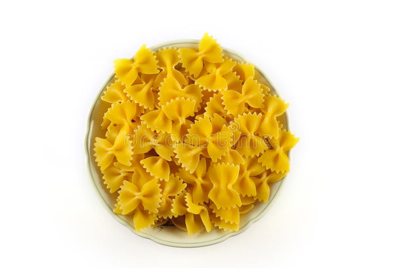 Bowl of raw pasta stock photography