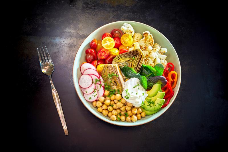 Bowl of raw vegetables stock image