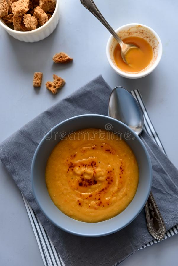 Bowl of red lentil soup on gray wooden background. Vegetarian food concept stock photos