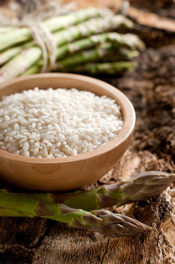 Bowl of rice with asparagus stock image