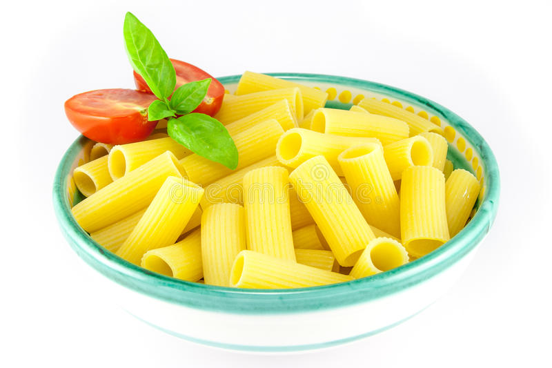 Download Bowl Of Rigatoni Pasta With Tomatoes And Basil Stock Photo - Image: 25196188