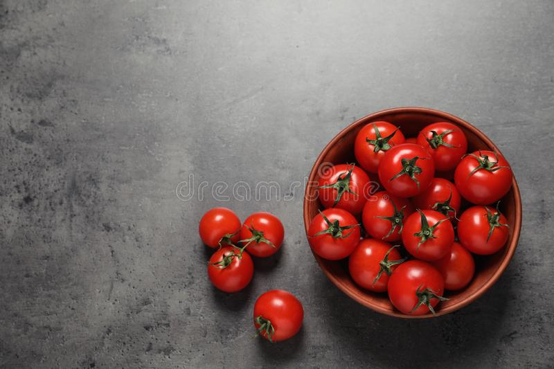Bowl with ripe cherry tomatoes, top view. Space for text royalty free stock photos
