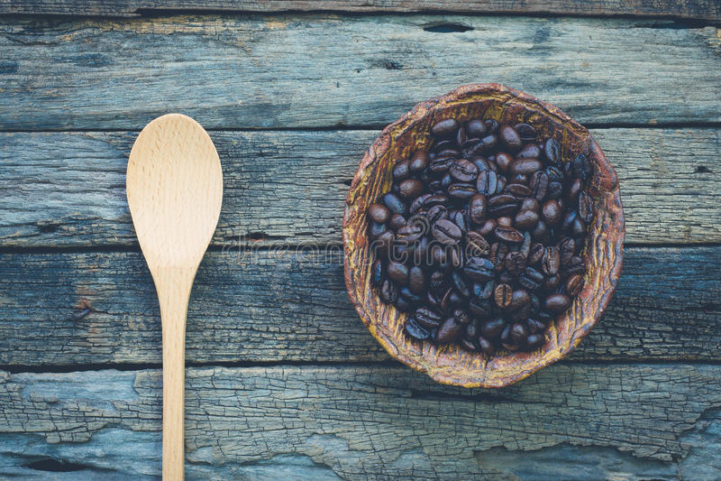 Bowl of roasted coffee beans and a spoon on very old and rustic stock images