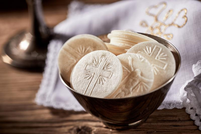 Bowl of sacramental bread for the Holy Communion. Bowl of sacramental bread or Hosties ready for the Holy Communion service representing the body of the stock photography