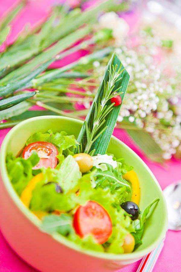 Bowl with a salad on the table stock images
