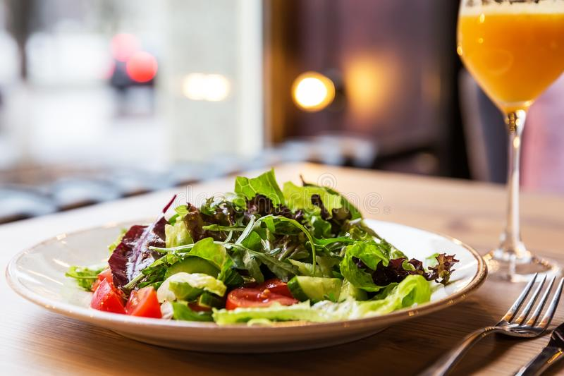 Bowl of salad with vegetables on wooden table stock image