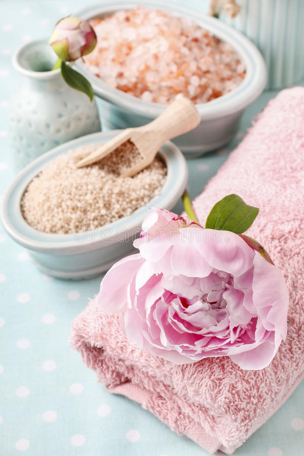 Bowl of sea salt and peony flower royalty free stock images