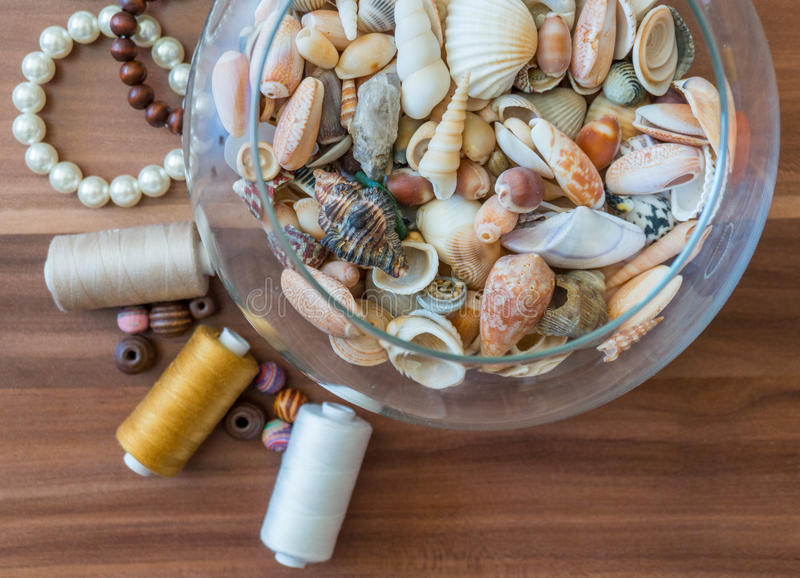 Bowl of seashells with pearls stock photo