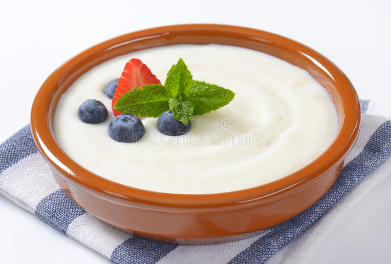 Bowl of semolina pudding with fruit stock photos