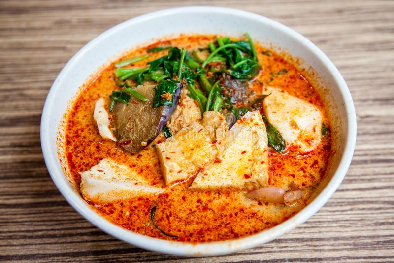 Popular Singapore Cuisine Laksa Yong Tau Foo. A bowl of Singapore Laksa Yong Tau Foo, a popular local dish served in spicy curry shrimp paste gravy soup base stock image