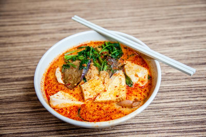 Popular Singapore Cuisine Laksa Yong Tau Foo. A bowl of Singapore Laksa Yong Tau Foo, a popular local dish served in spicy curry shrimp paste gravy soup base royalty free stock image
