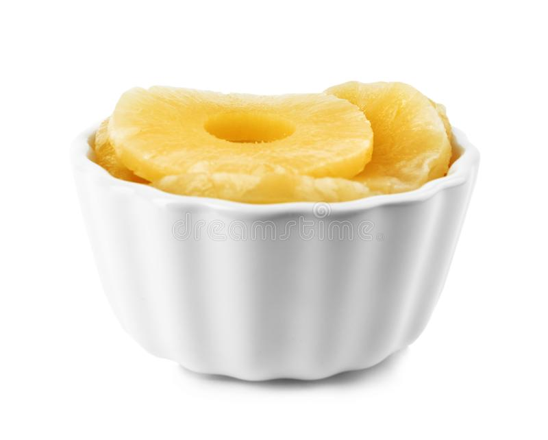 Bowl with slices of delicious sweet canned pineapple stock images