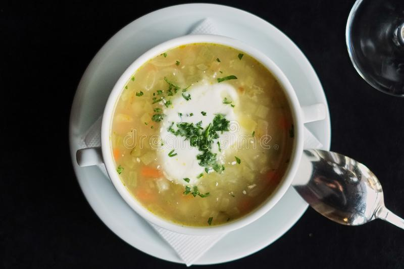 Bowl with soup served with glass .Delicious business lunch menu in cafe. stock photos
