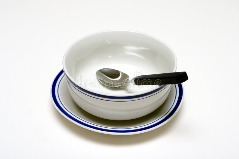 Bowl and Spoon stock images
