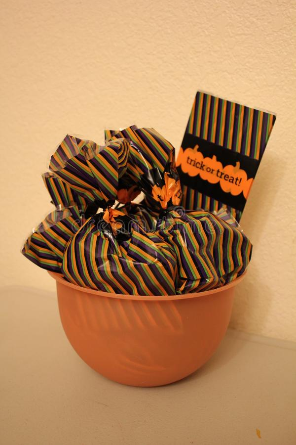 Bowl of Stiped Treat Bags stock images