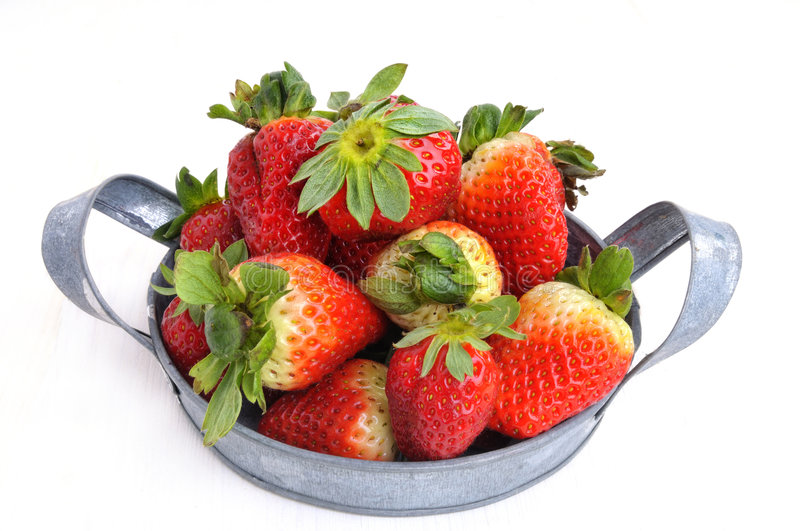 Bowl of strawberries. Bowl of fresh strawberries, isolated on white background stock photography