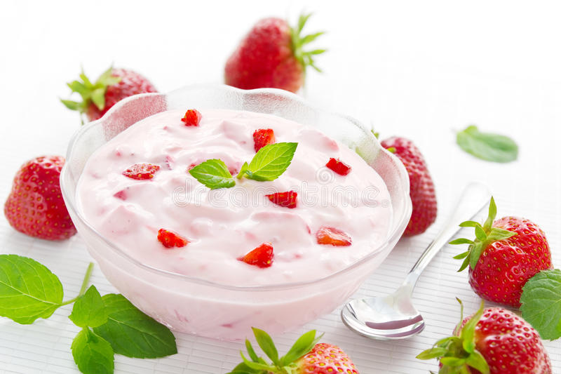 Bowl of strawberry yogurt stock images