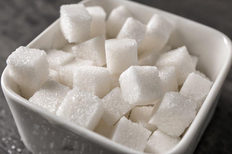 Bowl with sugar cubes, closeup royalty free stock image