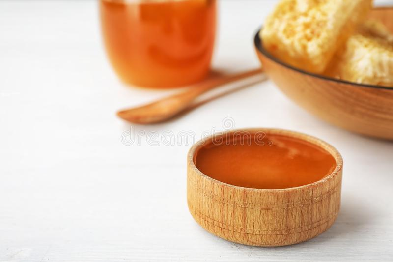 Bowl with sweet honey on table. Closeup royalty free stock photography