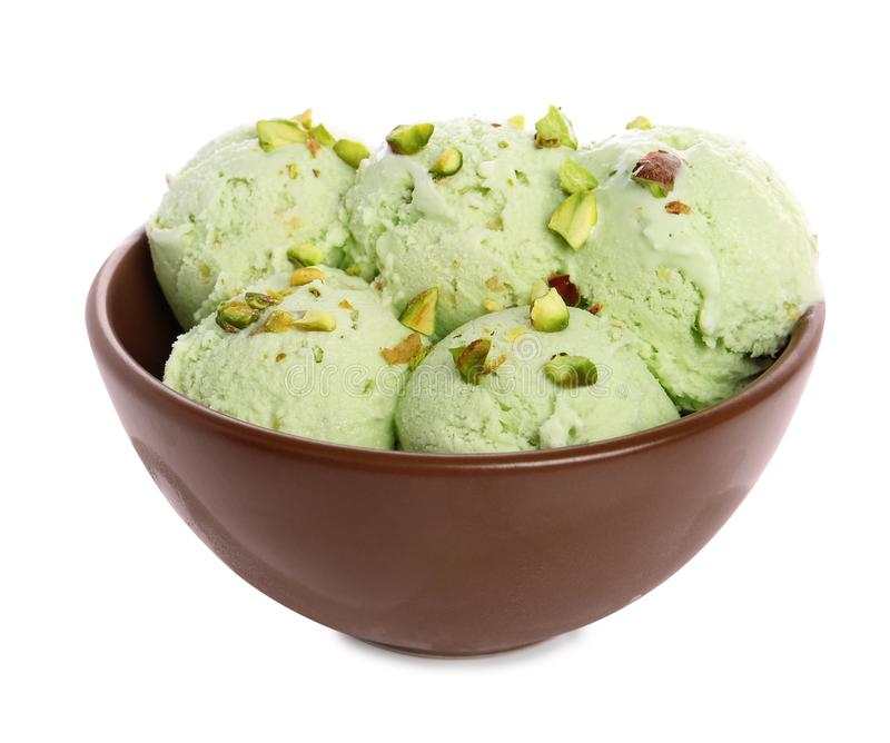Bowl of sweet pistachio ice cream. On white background royalty free stock images