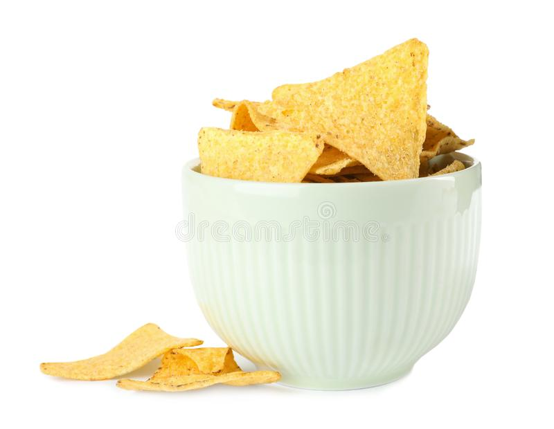 Bowl with tasty Mexican nachos chips on background royalty free stock photo