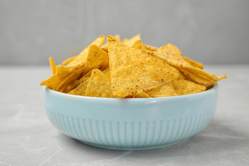 Bowl with tasty Mexican nachos chips stock image