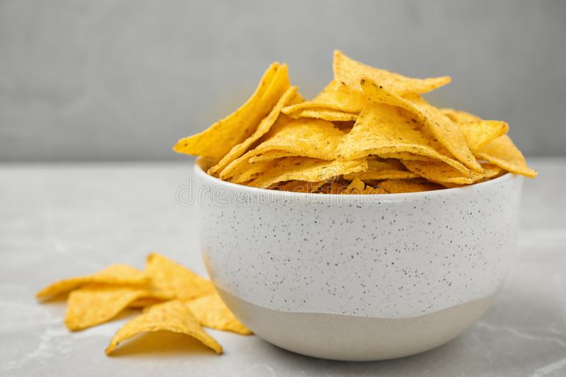 Bowl with tasty Mexican nachos chips, space for text royalty free stock photo