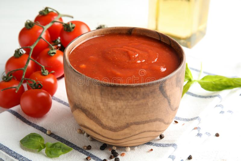 Bowl of tasty tomato sauce on table royalty free stock photo