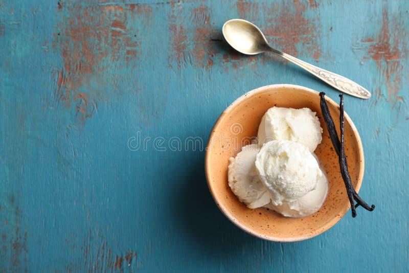 Bowl with tasty vanilla ice cream stock images