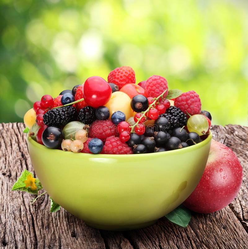 Bowl with a variety of berries stock images
