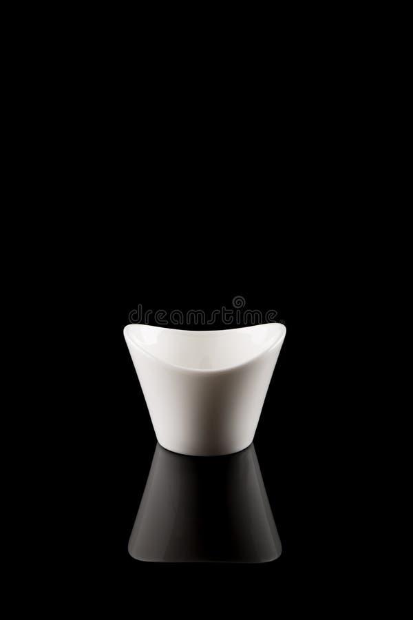 Bowl, White Porcelain modern Design Bowl, empty uneven edges. Bowl, White Porcelain modern Design Bowl, empty with beautiful uneven edges isolated on black stock photography