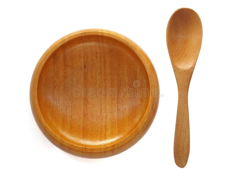 Bowl and wooden spoon. On a white background stock image