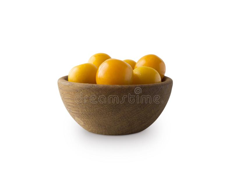 Bowl with yellow plums cherry-plum isolated on white background royalty free stock image