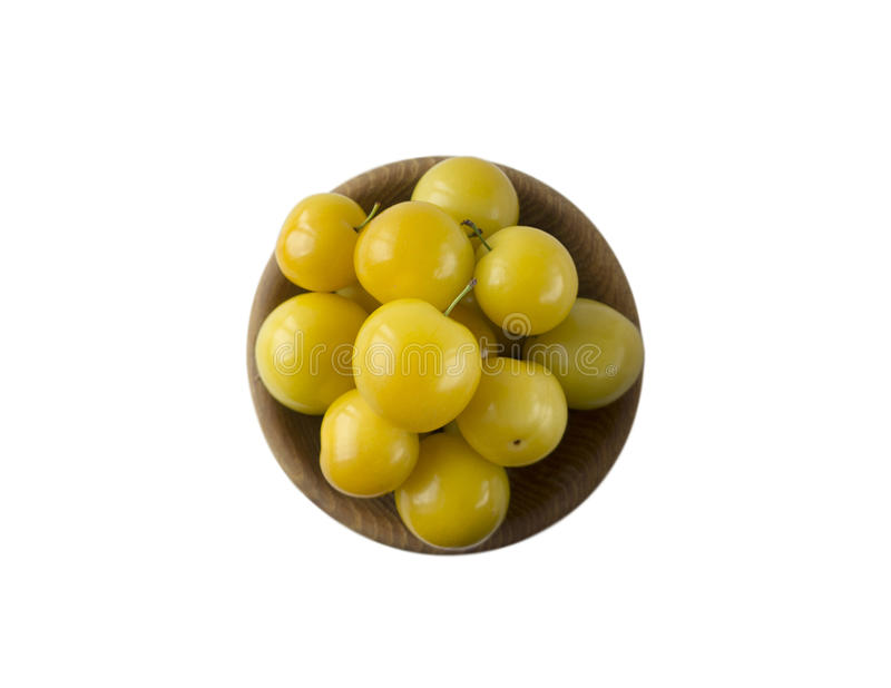Bowl with yellow plums isolated on white background stock photos