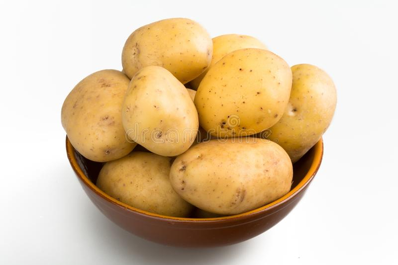 Bowl of Yukon gold potatoes royalty free stock photography