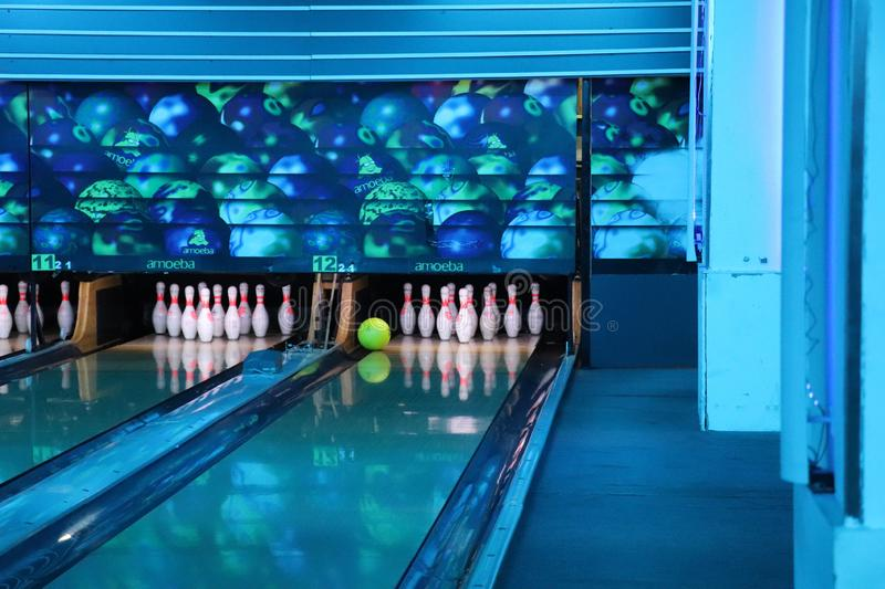 Bowling alley bowl missing pins by inches. While bowling the bowl misses out on hitting the pins by a very few inches and does not touches the pins. Thus showing royalty free stock images