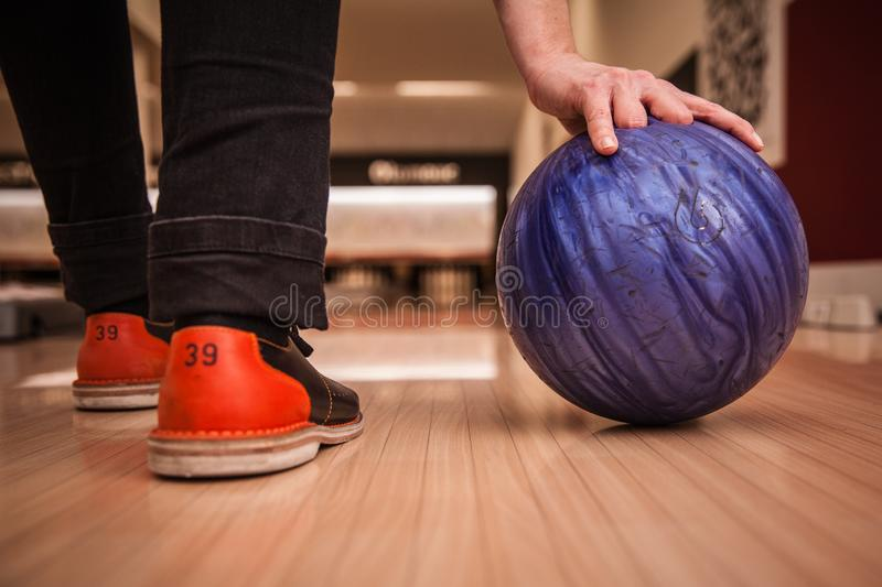 Bowling ball in action with a game of bowling. In sports center royalty free stock images