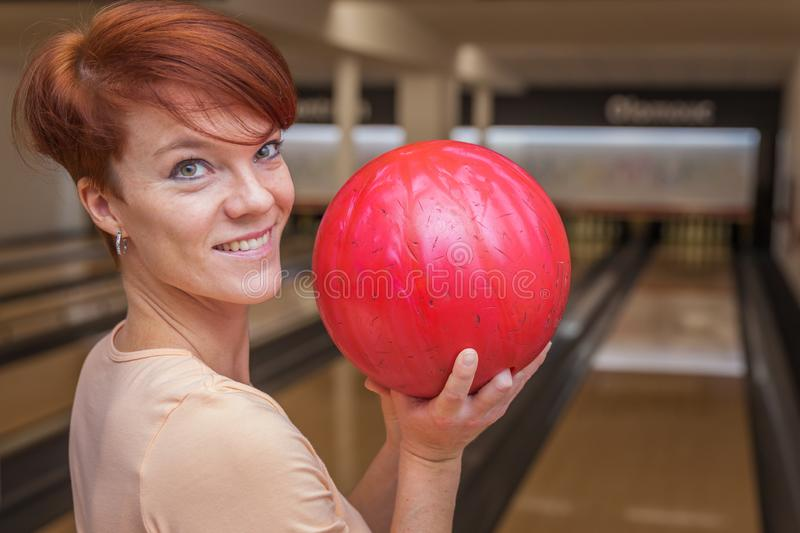 Bowling ball in action with a game of bowling. In sports center royalty free stock photography