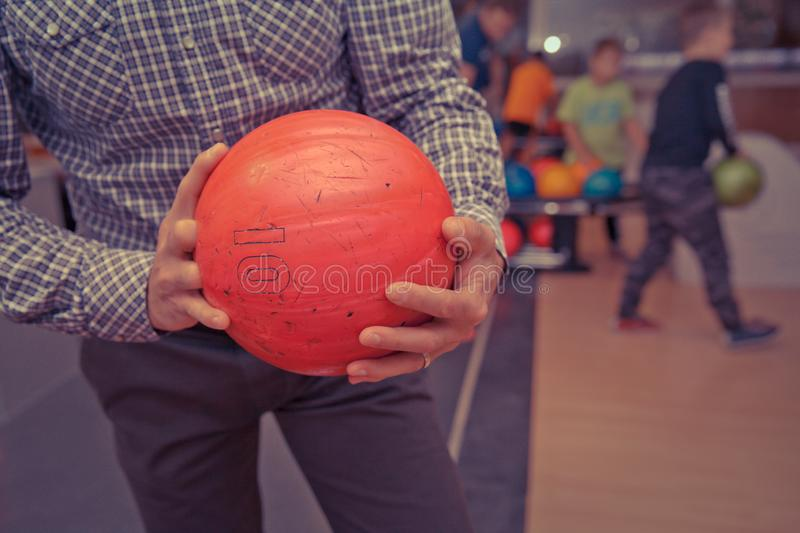 Bowling ball in action with a game of bowling. In sports center stock photography