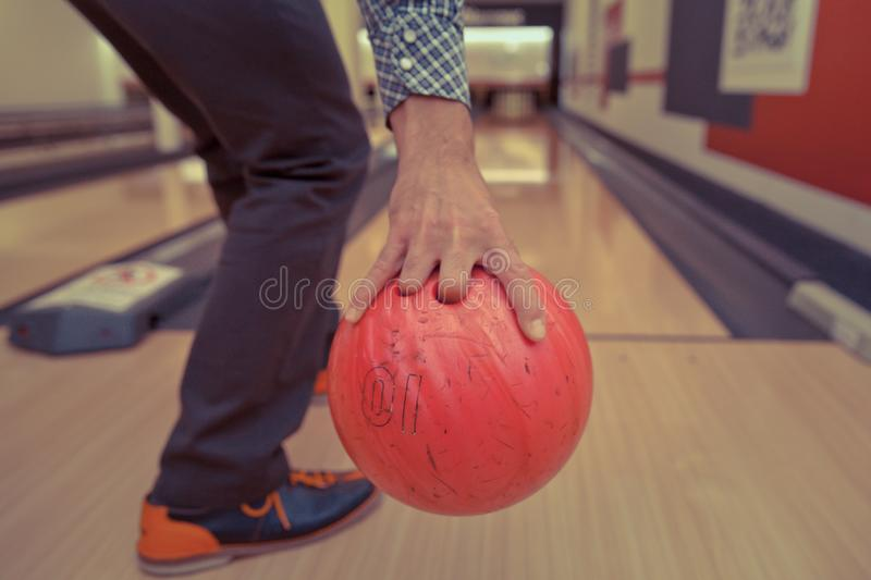 Bowling ball in action with a game of bowling. In sports center stock images