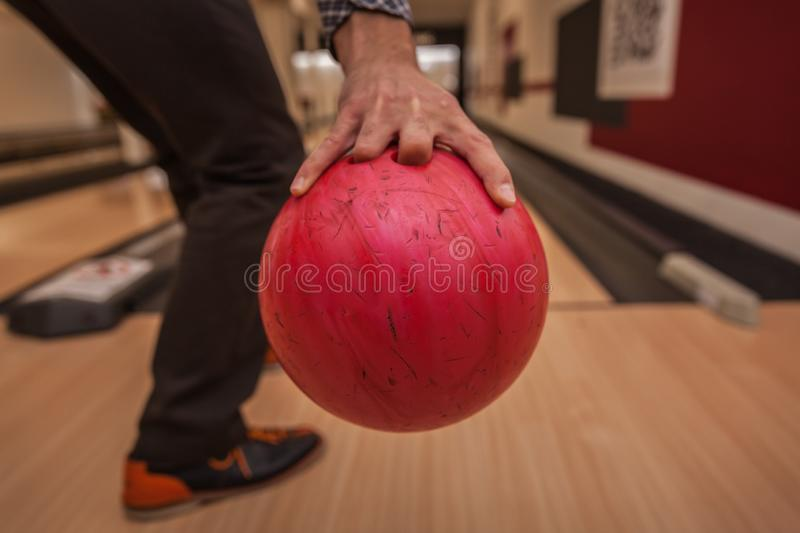 Bowling ball in action with a game of bowling in sports center. Red bowling ball in action with a game of bowling in sports center stock images