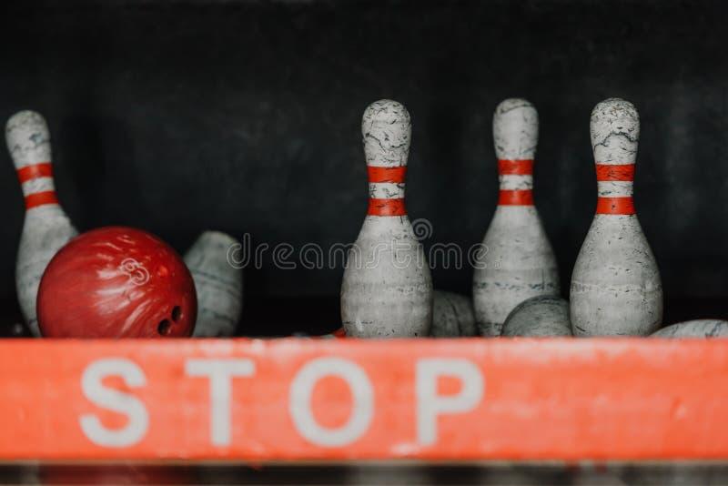 bowling ball crushing pins behind royalty free stock image