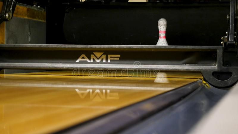 Bowling ball knocks down pins. Media. Bowling ball on the track in order to knock down the pins.  stock image